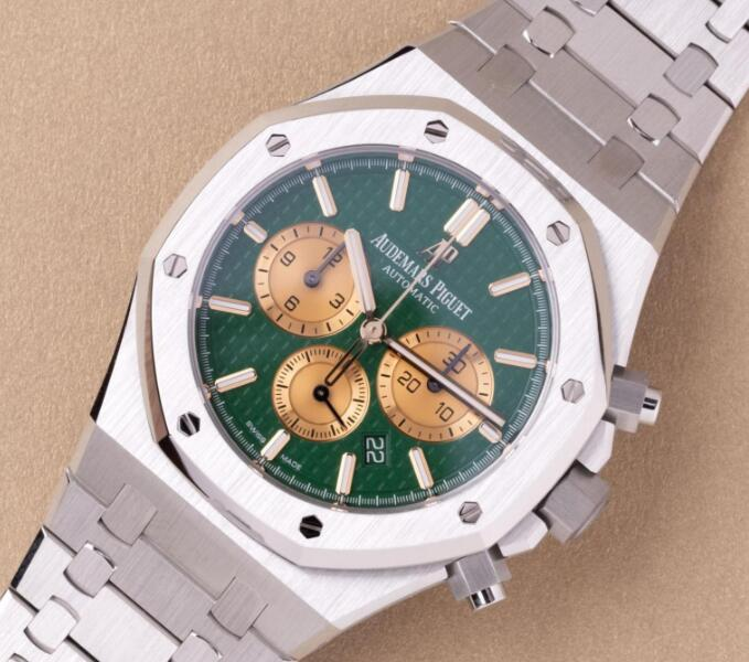 The gold sub-dials are striking on the green dial.